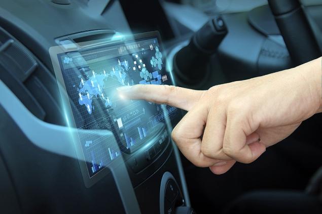 Cars as Wi-Fi hotspots - hand pushing on car screen interface